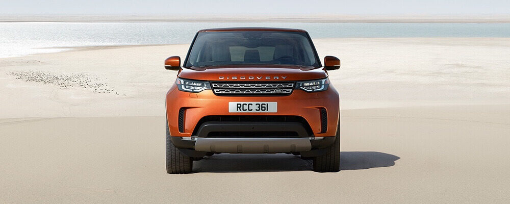 2017 Land Rover Discovery front view, orange exterior model