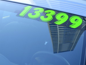 Retail Business Image of A Price Sticker On A Used Car